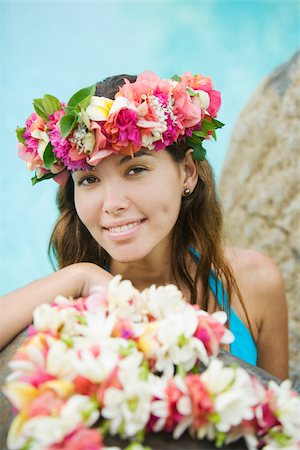 french polynesia - Young woman with flowers in hair in moorea Stock Photo - Premium Royalty-Free, Code: 614-02679645
