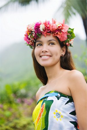 french polynesia - Young woman with flowers in hair in moorea Stock Photo - Premium Royalty-Free, Code: 614-02679643