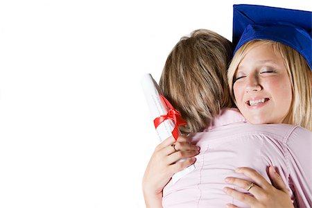 Mother hugging graduating daughter Stock Photo - Premium Royalty-Free, Code: 614-02680703