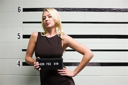 Mugshot of female criminal Stock Photo - Premium Royalty-Free, Code: 614-02739976