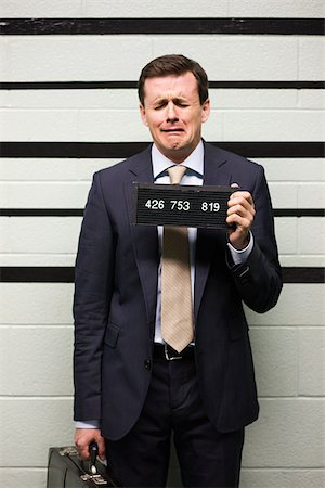 Mugshot of businessman Stock Photo - Premium Royalty-Free, Code: 614-02739970