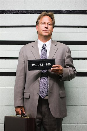Mugshot of businessman Stock Photo - Premium Royalty-Free, Code: 614-02739985
