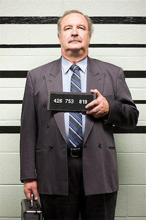 Mugshot of businessman Stock Photo - Premium Royalty-Free, Code: 614-02739998