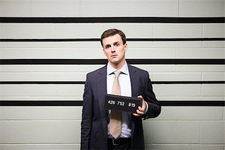 Mugshot of businessman Stock Photo - Premium Royalty-Free, Code: 614-02740003
