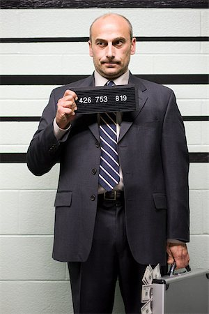 Mugshot of businessman Stock Photo - Premium Royalty-Free, Code: 614-02740045