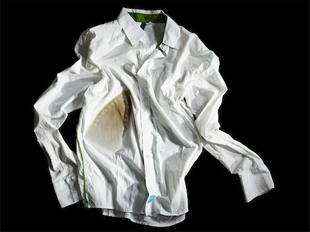 A crumpled burned white shirt Stock Photo - Premium Royalty-Free, Code: 614-02740483