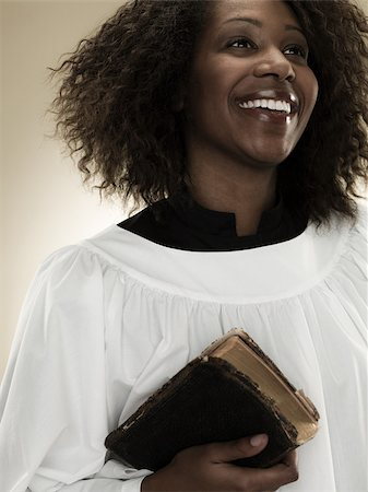 A gospel singer holding a bible Stock Photo - Premium Royalty-Free, Code: 614-02764155