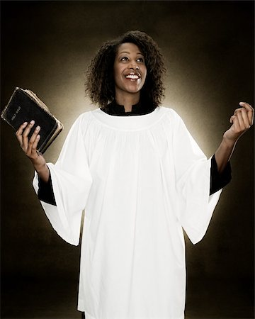 A gospel singer holding a bible Stock Photo - Premium Royalty-Free, Code: 614-02764175