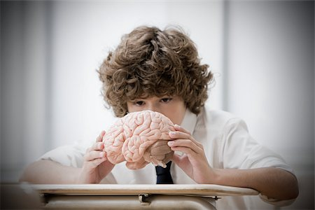 Boy with model brain Stock Photo - Premium Royalty-Free, Code: 614-02762646