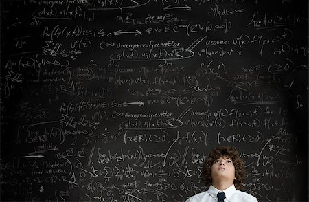 formula - Boy in front of blackboard Stock Photo - Premium Royalty-Free, Code: 614-02762785