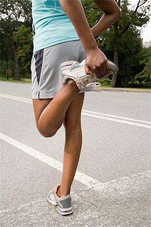 Runner stretching leg Stock Photo - Premium Royalty-Free, Code: 614-02763065