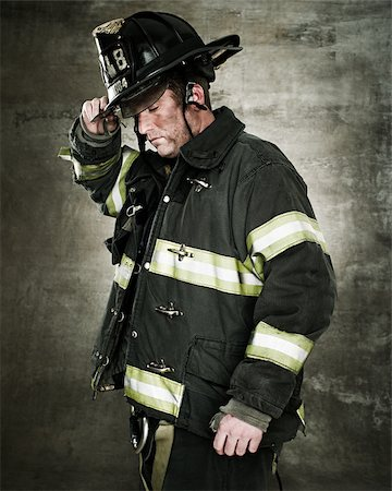Portrait of a firefighter Stock Photo - Premium Royalty-Free, Code: 614-02763930