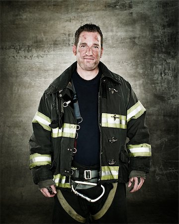 Portrait of a firefighter Stock Photo - Premium Royalty-Free, Code: 614-02763940