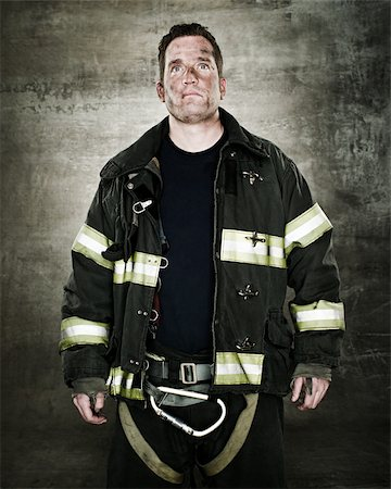 Portrait of a firefighter Stock Photo - Premium Royalty-Free, Code: 614-02763965