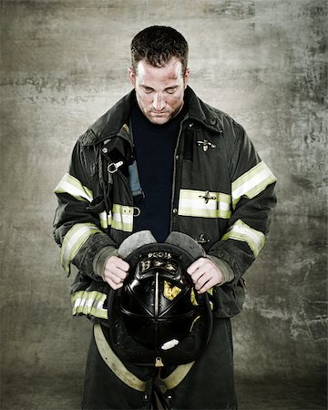 Portrait of a firefighter Stock Photo - Premium Royalty-Free, Code: 614-02763971
