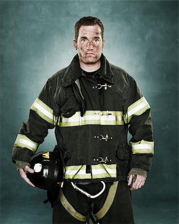 Portrait of a firefighter Stock Photo - Premium Royalty-Free, Code: 614-02763982