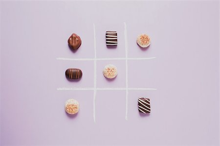 Chocolates on grid Stock Photo - Premium Royalty-Free, Code: 614-02838595