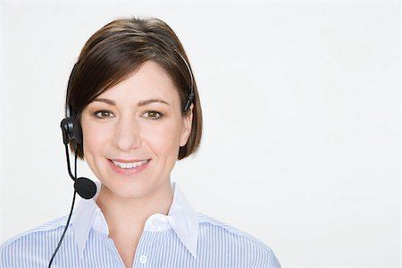 Woman wearing telephone headset Stock Photo - Premium Royalty-Free, Code: 614-02933971