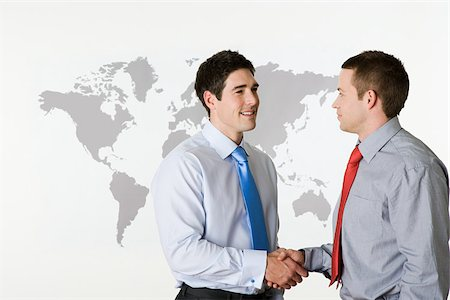 Businessmen shaking hands Stock Photo - Premium Royalty-Free, Code: 614-02933993