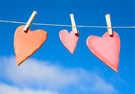 string - Three hearts on a washing line Stock Photo - Premium Royalty-Free, Code: 614-02984888