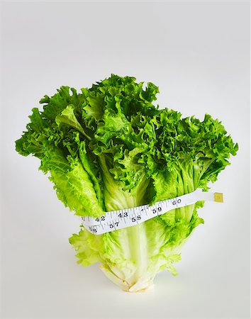 Tape measure around lettuce Stock Photo - Premium Royalty-Free, Code: 614-02984898