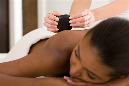 Woman having stone massage Stock Photo - Premium Royalty-Free, Code: 614-02983916