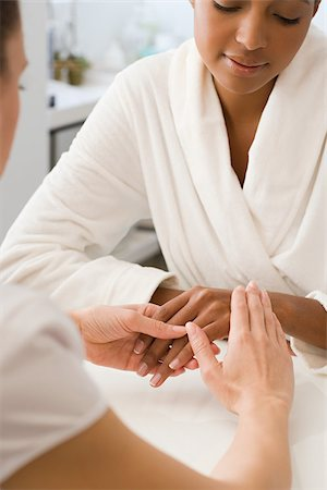 Woman having hands massaged Stock Photo - Premium Royalty-Free, Code: 614-02983948