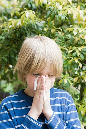people coughing or sneezing - Boy blowing his nose Stock Photo - Premium Royalty-Free, Code: 614-03020241