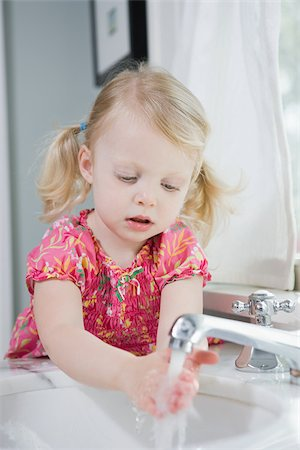 Girl washing her hands Stock Photo - Premium Royalty-Free, Code: 614-03020259