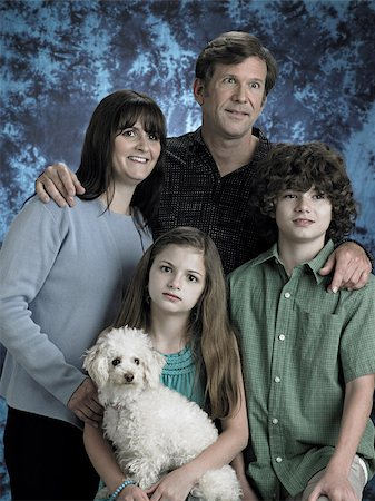 quirky - Portrait of a family with poodle Stock Photo - Premium Royalty-Free, Code: 614-03191028