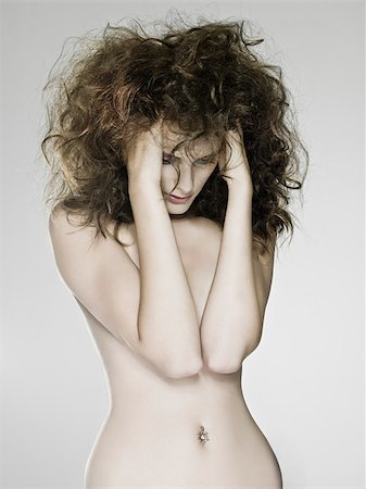 Nude woman with hands in hair Stock Photo - Premium Royalty-Free, Code: 614-03191128