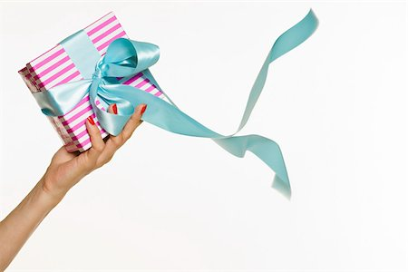Female hand holding a gift Stock Photo - Premium Royalty-Free, Code: 614-03191313