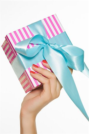 Female hand holding a gift Stock Photo - Premium Royalty-Free, Code: 614-03191347