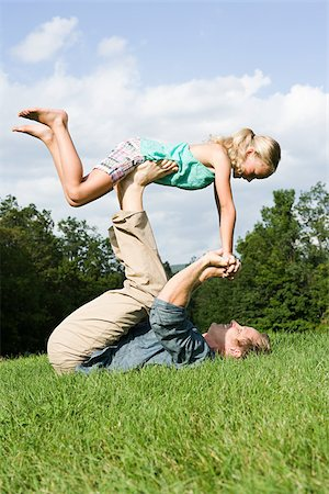 Father and daughter playing in park Stock Photo - Premium Royalty-Free, Code: 614-03191566