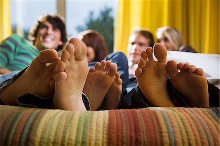 female 16 year old feet - Friends on bed with bare feet Stock Photo - Premium Royalty-Free, Code: 614-03241360