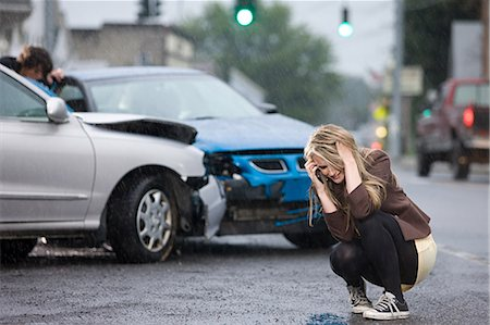 people in panic - Young woman involved in road accident Stock Photo - Premium Royalty-Free, Code: 614-03241385