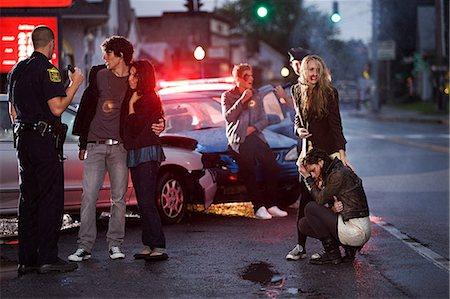 people in panic - Young people and police officer at scene of car crash Stock Photo - Premium Royalty-Free, Code: 614-03241383