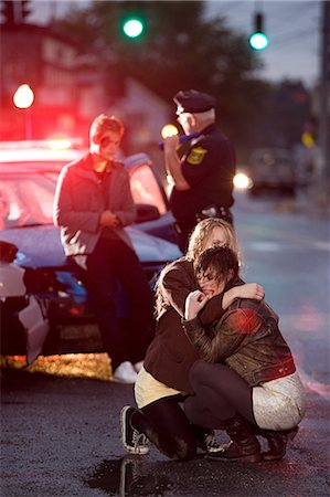people in panic - Young people and police officer at scene of car crash Stock Photo - Premium Royalty-Free, Code: 614-03241416