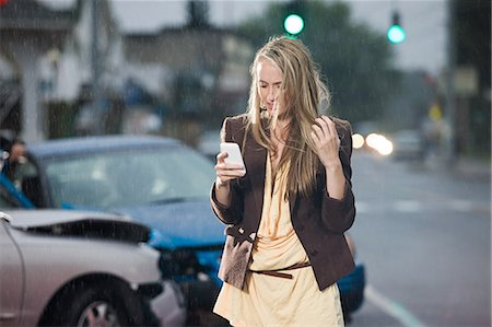 people in panic - Young woman and car crash Stock Photo - Premium Royalty-Free, Code: 614-03241412