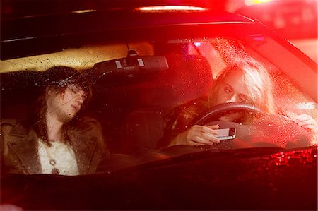 dangerous accident - Two young women in a car accident Stock Photo - Premium Royalty-Free, Code: 614-03241426