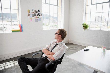 Fashion designer sitting on chair Stock Photo - Premium Royalty-Free, Code: 614-03420154