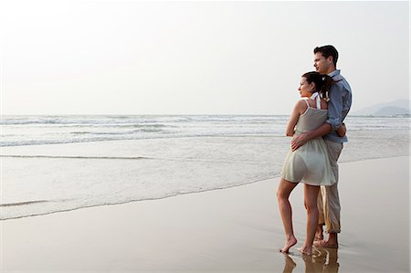 Couple looking out to the ocean Stock Photo - Premium Royalty-Free, Code: 614-03454626