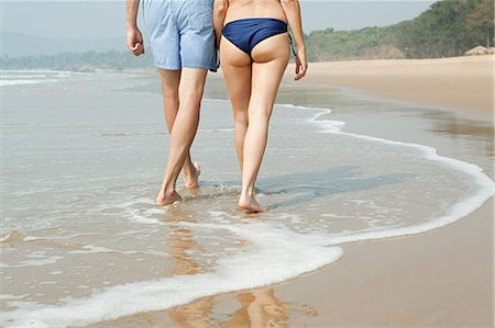 Legs of couple walking in sea Stock Photo - Premium Royalty-Free, Code: 614-03454635