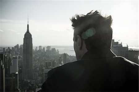 Man looking over new york city Stock Photo - Premium Royalty-Free, Code: 614-03455117