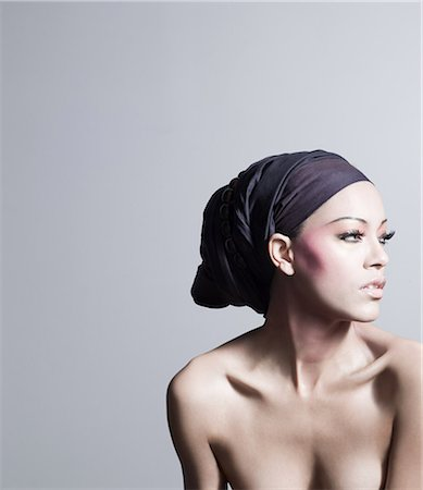Young woman wearing head tie Stock Photo - Premium Royalty-Free, Code: 614-03468692