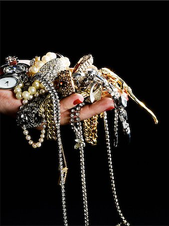 expensive jewelry - Woman holding jewelry Stock Photo - Premium Royalty-Free, Code: 614-03468737