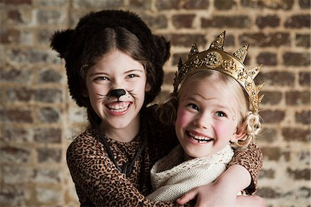 preteen girl pussy - Young girls dressed up as cat and queen Stock Photo - Premium Royalty-Free, Code: 614-03469543