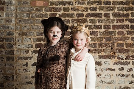 preteen girl pussy - Young girls dressed up as cat and queen Stock Photo - Premium Royalty-Free, Code: 614-03469560