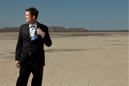 sweaty businessman - Businessman in desert Stock Photo - Premium Royalty-Free, Code: 614-03507056