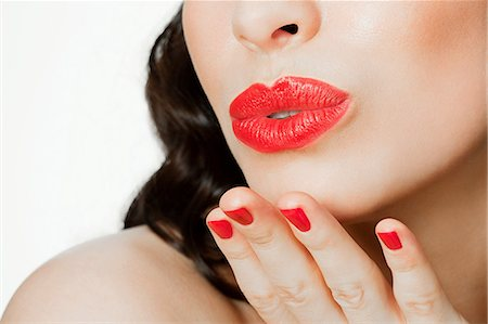 Young woman blowing a kiss Stock Photo - Premium Royalty-Free, Code: 614-03507559